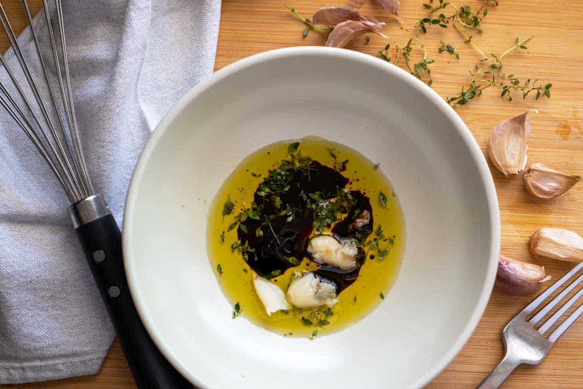 Bowl of olive oil, balsamic and roast garlic.