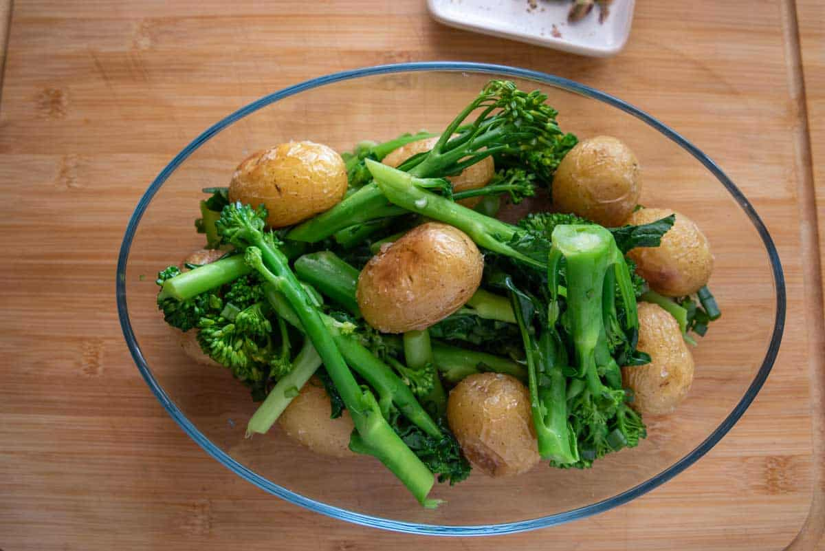 Bowl with roast potatoes and parboiled broccoli.