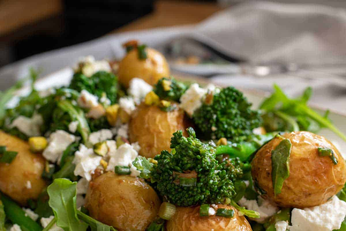 Close up of roast potato salad with broccoli.