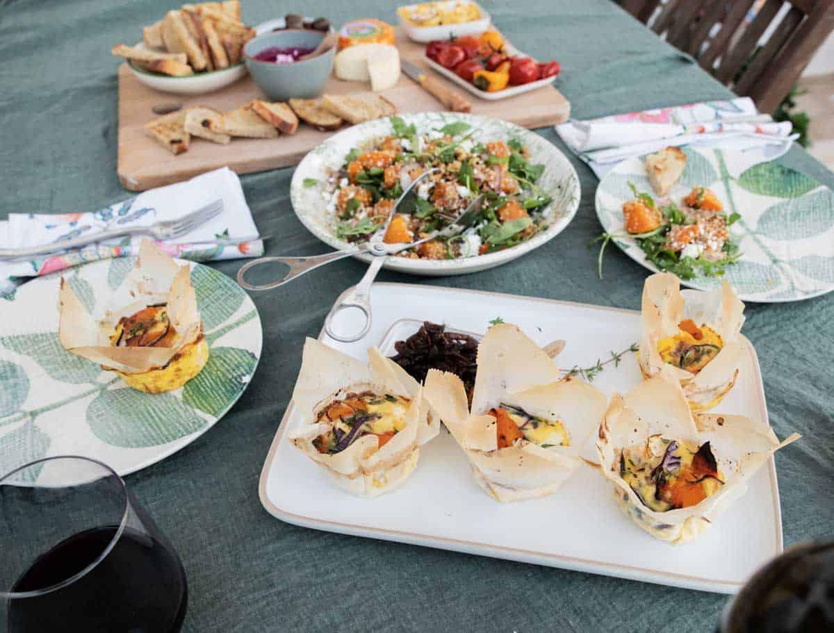 Fall picnic spread with pumpkin frittata and pumpkin quinoa salad.