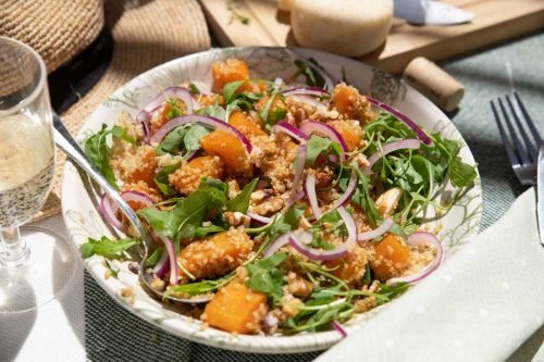 Bowl of spiced pumpkin and quinoa salad for a picnic.