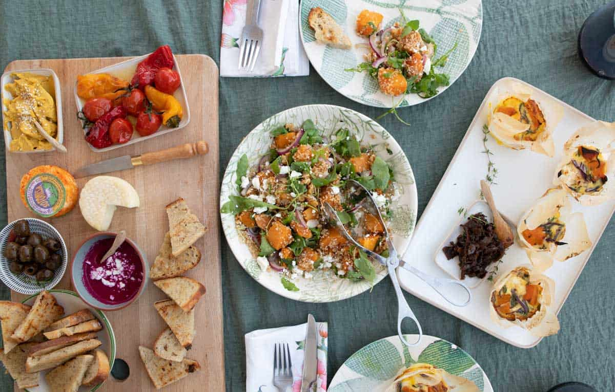 Picnic spread with mezze platter, pumpkin salad and frittata.