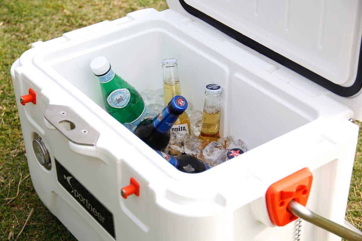 Cooler box filled with ice and beer.