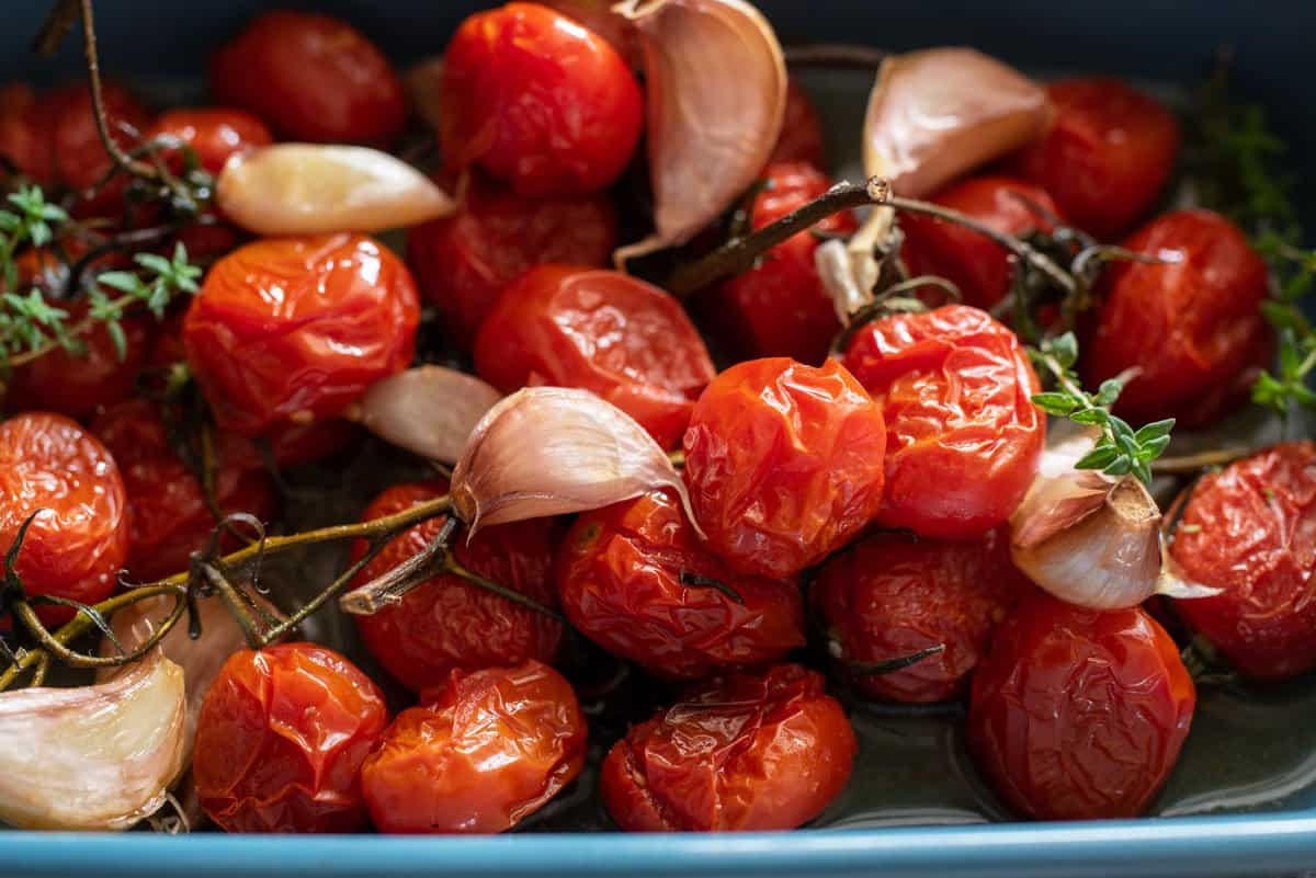Roasted tomatoes with roast garlic cloves.