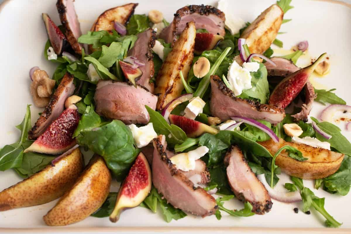 Brightly coloured smoked duck, fig and grilled pear salad.