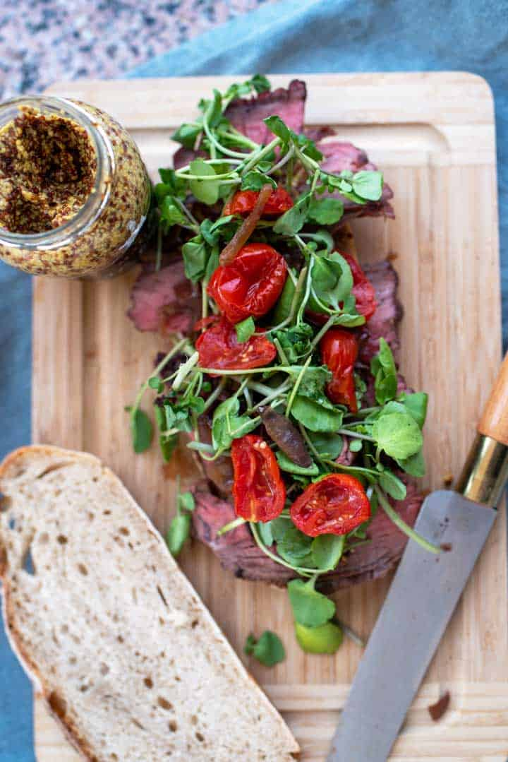 Open roast beef sandwich with roasted vine tomatoes.