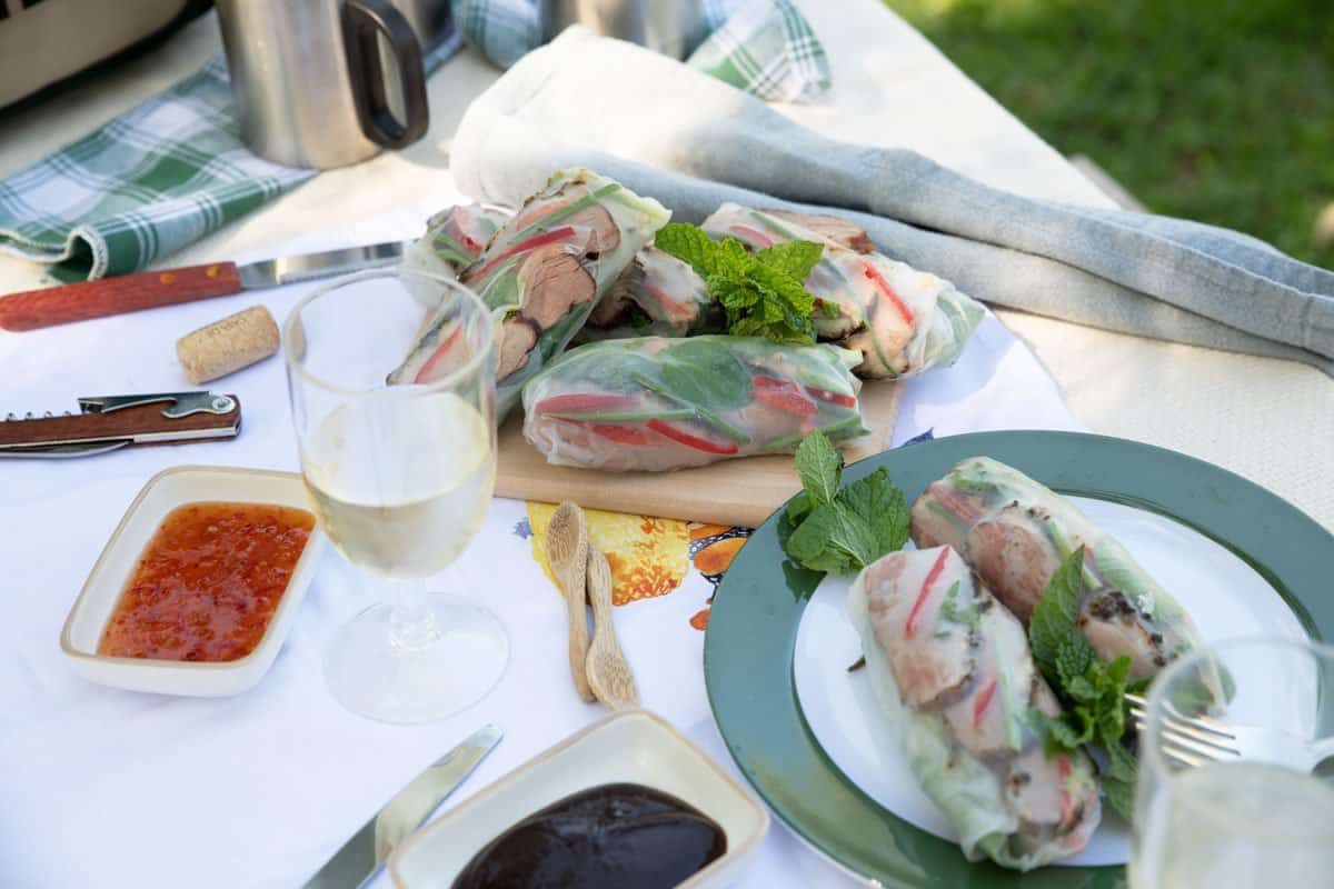 Asian style picnic lunch with smoked duck rice paper rolls.