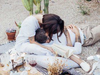 Young couple kissing at a romantic picnic