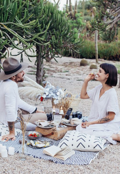 Attractive hipster couple having a romantic.picnic
